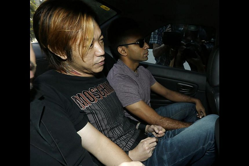 Lim Hou Peng Jackson, 40, was charged in court with the murder of Vietnamese woman Tran Cam Ny, 32, in an Ang Mo Kio flat. -- ST PHOTO: WONG KWAI CHOW