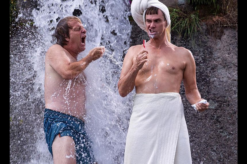 Jeff Daniels (left) and Jim Carrey's Dumb And Dumber To was slammed by critics, but the audience loved it. -- PHOTO: GOLDEN VILLAGE PICTURES