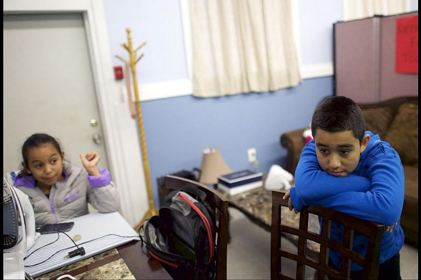 Ms Angela Navarro, an undocumented immigrant with a deportation order, and her children Arturo, 11, and Angela, eight, have taken refuge in a US church as part of action aimed at pressing President Barack Obama on immigration reform. Mr Obama has cla