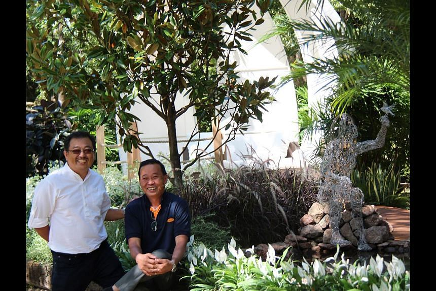 Award-winning duo John Tan (left) and Raymond Toh (right) at the Gardening World Cup in Japan last year.
