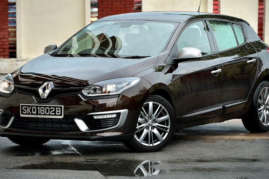 The new Renault Megane GT-Line's unusual looks make it a head-turner but the design of its cup holder is just odd.