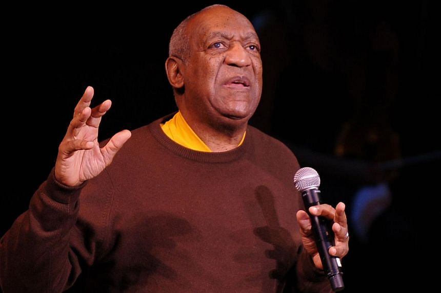 """An Oct 21, 2010 file photo shows comedian Bill Cosby performing onstage in New York City.Cosby and Las Vegas' Treasure Island casino have cancelled his scheduled Nov 28 show by """"mutual agreement,"""" the casino said in a statement on Friday. -- PH"""