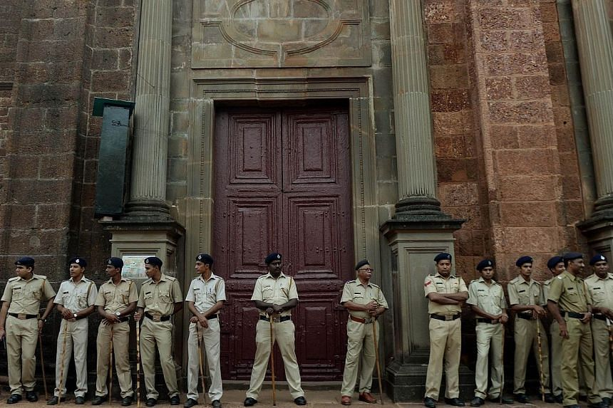 Policemen stand guard outside the Basilica of Bom Jesus before the start of a procession carrying the remains of St Francis Xavier in Goa on Nov 22, 2014. -- PHOTO: AFP