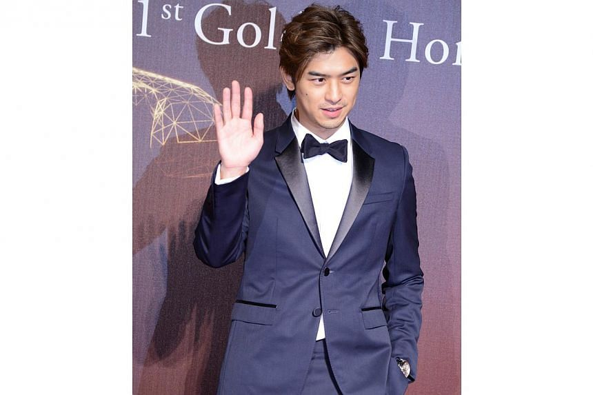 Taiwanese actor Chen Bolin arrives ahead of the Golden Horse Film Awards in Taipei on Nov 22, 2014. -- PHOTO: AFP