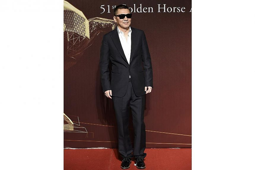 Chinese director and actor Chen Jianbin poses on the red carpet at the 51st Golden Horse Film Awards in Taipei on Nov 22, 2014. -- PHOTO: REUTERS