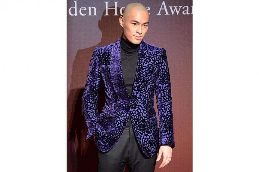 Taiwanese actor Tony Yang arrives ahead of the Golden Horse Film Awards in Taipei on Nov 22, 2014. -- PHOTO: AFP