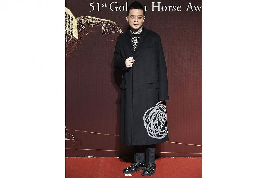 Hong Kong singer Anthony Wong poses for photographers on the red carpet at the 51st Golden Horse Film Awards in Taipei on Nov 22, 2014. -- PHOTO: REUTERS