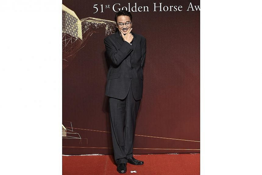 Hong Kong actor Ng Man-tat poses on the red carpet at the 51st Golden Horse Film Awards in Taipei on Nov 22, 2014. -- PHOTO: REUTERS