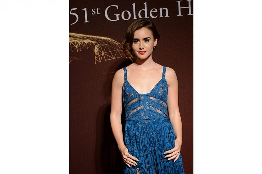 US actress Lily Collins arrives ahead of the Golden Horse Film Awards in Taipei on Nov 22, 2014. -- PHOTO: AFP