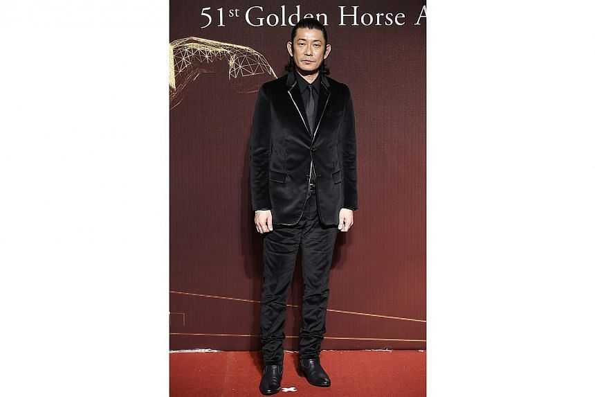 Japanese actor Masatoshi Nagase poses for photographers on the red carpet at the 51st Golden Horse Film Awards in Taipei on Nov 22, 2014. -- PHOTO: REUTERS