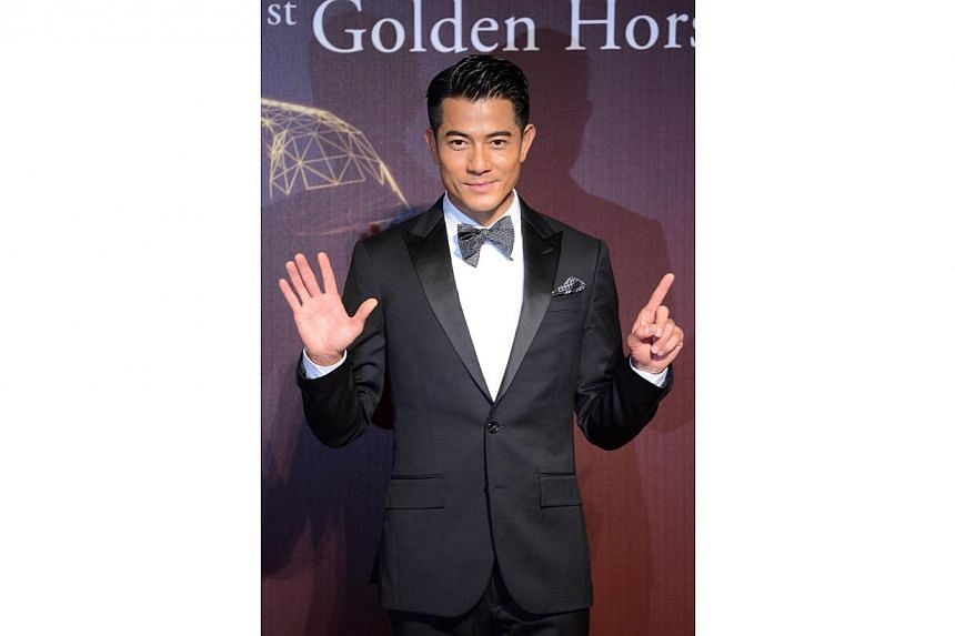 Hong Kong actor Aaron Kwok arrives ahead of the Golden Horse Film Awards in Taipei on Nov 22, 2014. -- PHOTO: AFP