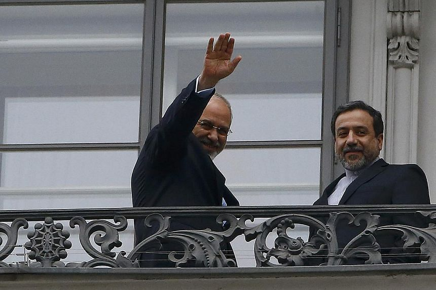 Iranian Foreign Minister Javad Zarif (left) and Abbas Araghchi, Iran's chief nuclear negotiator, stand on the balcony of Palais Coburg during a meeting between Iran and six world powers in Vienna Nov 22, 2014.Teheran is ready to allow nuclear i