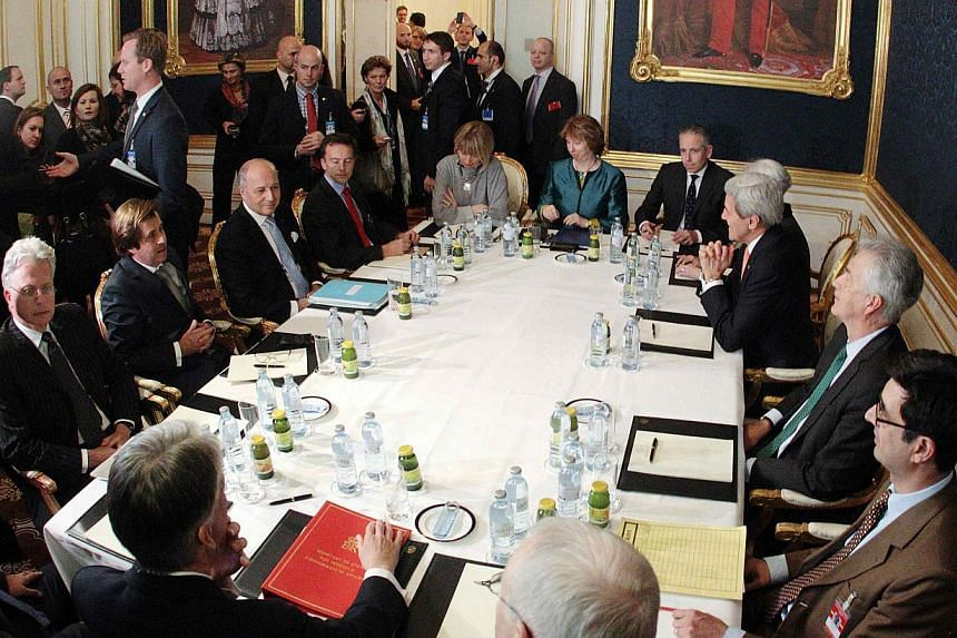 French Foreign Minister Laurent Fabius (third left), EU envoy Catherine Ashton (sixth left), US Secretary of State John Kerry (third right) and Britain's Foreign Secretary Philip Hammond (front left) sit at a table during talks in Vienna Nov 21, 2014