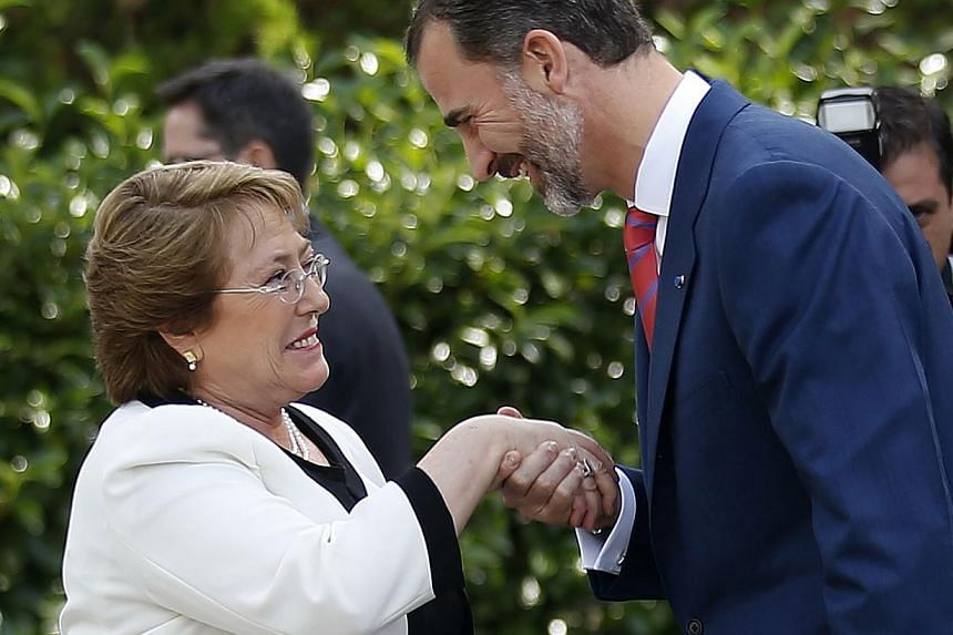 Spain's King Felipe (right) welcoming Chile's President Michelle Bachelet at Madrid's Zarzuela palace Oct 29, 2014.A Chilean judge jailed two retired colonels on Friday for torturing President Michelle Bachelet's father, who was arrested