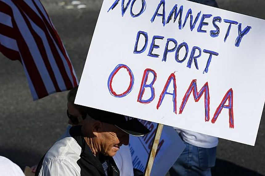Anti-Obama protesters angered by the President's immigration plans in Las Vegas, Nevada on Nov 21, 2014. Mexico's President on Friday joined Central American leaders and Latino celebrities in applauding US President Barack Obama's landmark offer to s
