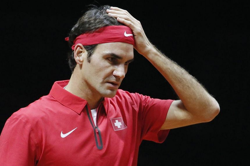 Switzerland's Roger Federer reacts during his Davis Cup final singles tennis match against France's Gael Monfils on Nov 21, 2014. Honours were shared between France and Switzerland in the Davis Cup final in Lille on Friday on a day when Roger Federer