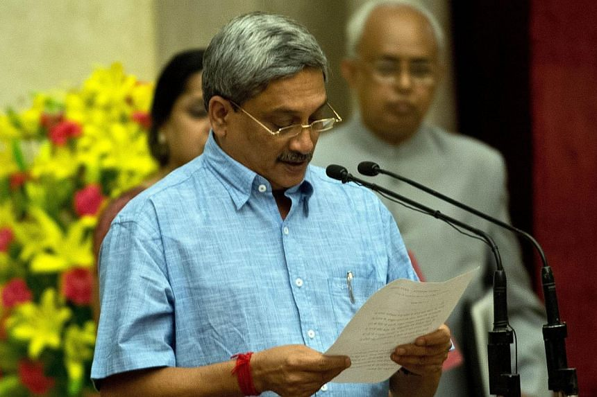 The Defence Acquisition Council, which clears high-value military procurements, issued the tender after holding its first meeting under new Defence Minister Manohar Parrikar (pictured). -- PHOTO: AFP