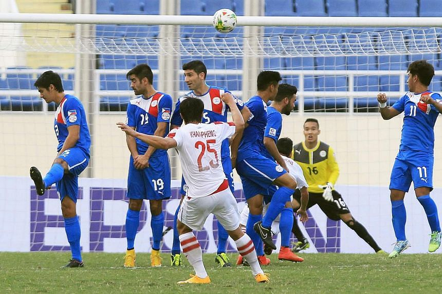 Laos' Khampheng Sayavutthi(centre) scores against the Philippines during their AFF Suzuki Cup match at My Dinh stadium in Hanoi on Nov 22, 2014. -- PHOTO: REUTERS