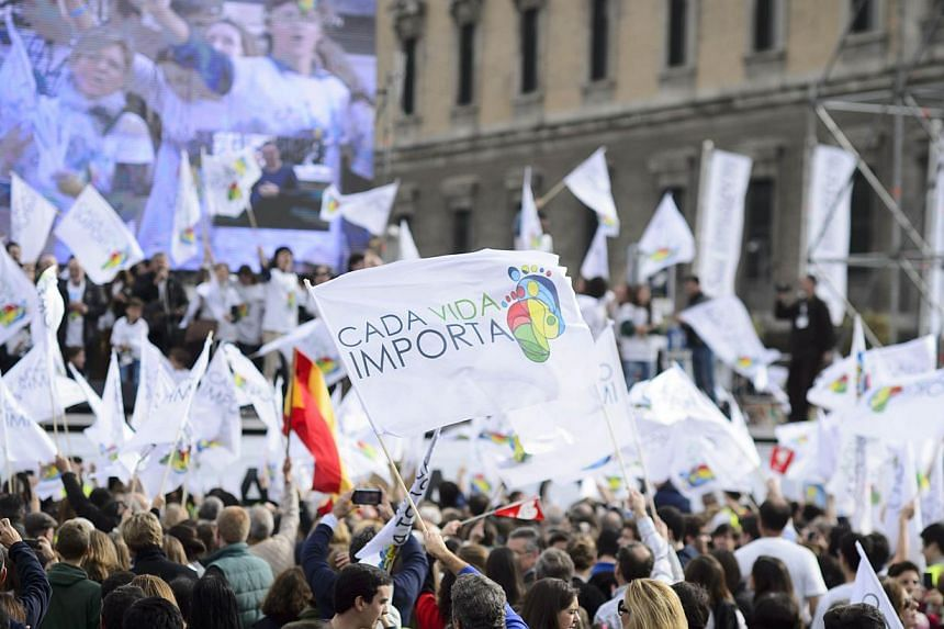 "Supporters hold flags reading ""Every life matters"" during a march against abortion in Madrid on Sept 22, 2014. -- PHOTO: AFP"