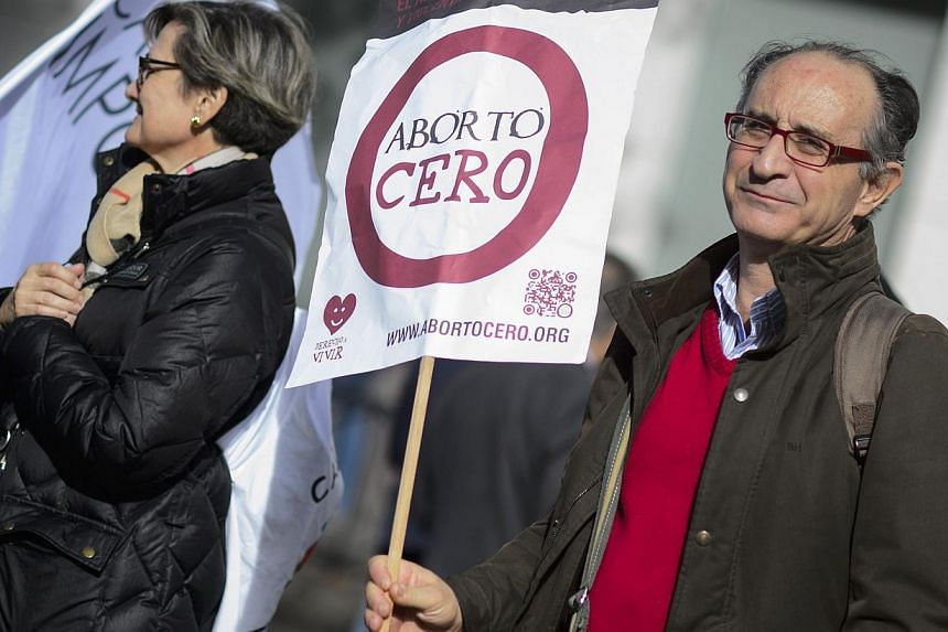 "A supporter holds a placard reading ""Zero abortion"" during a march against abortion in Madrid on Sept 22, 2014. -- PHOTO: AFP"