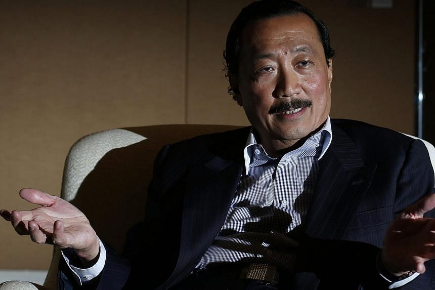 """Malaysian billionaire Vincent Tan speaks to Reuters during an interview in Singapore Oct 29, 2014.Cardiff owner Tan said Wigan are run by a """"racist chairman"""" who had hired a """"racist manager"""" as fallout from the appointment of Malky Mackay as te"""