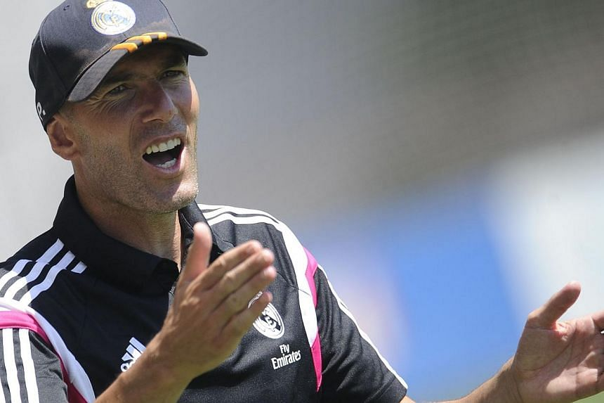 A Spanish sports court on Friday backed Zinedine Zidane's (above) appeal against a three month ban from coaching Real Madrid's reserve team over his disputed qualifications. -- PHOTO: AFP