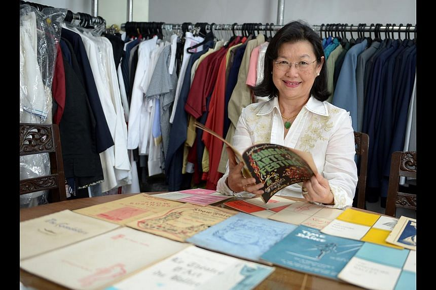 Former ballerina Helen Lyou with her personal collection of music and dance programmes dating back to the 1950s, and the programme from Maudrene's School of Dancing (above). -- ST PHOTO: JAMIE KOH