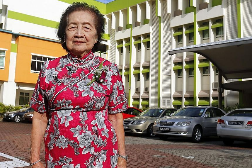 Mrs Eunice Tan was among Griffiths' first teachers when it opened in Towner Road in 1950, and was at its current location for its closing ceremony. Two generations of Qiaonan pupils taking a photo outside the school before its merger. Mr Ahmad Salik
