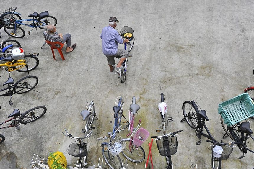 Members of the public can now park their bicycles with greater peace of mind. -- ST PHOTO: ASHLEIGH SIM
