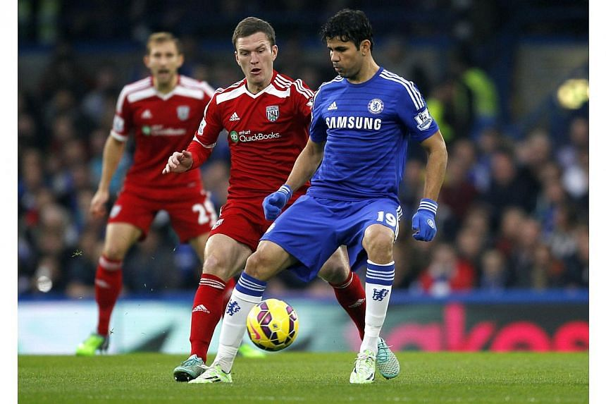 West Bromwich Albion's English midfielder Craig Gardner (left) vies with Chelsea's Brazilian-born Spanish striker Diego Costa during the English Premier League football match between Chelsea and West Bromwich Albion at Stamford Bridge in London on