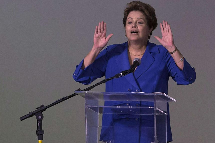 A month after winning re-election, Brazilian President Dilma Rousseff (above) is battling the toughest of starts to her second term with a huge corruption scandal at state-owned oil giant Petrobras threatening to engulf her government. -- PHOTO: REUT