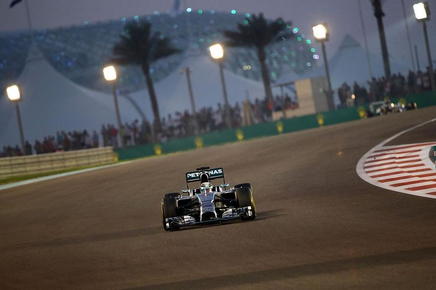 Mercedes' British driver Lewis Hamilton races during the of the Abu Dhabi Formula One Grand Prix at the Yas Marina circuit on November 23, 2014. -- PHOTO: AFP