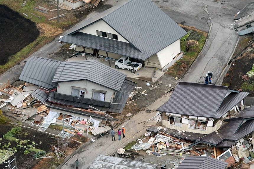 An aerial view shows collapsed houses after an earthquake in Hakuba town, Nagano prefecture, on Nov 23, 2014. -- PHOTO: REUTERS