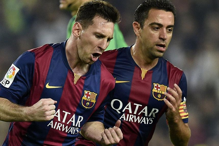 Barcelona's Argentinian forward Lionel Messi celebrates after scoring during the Spanish league football match FC Barcelona versus Sevilla FC at the Camp Nou stadium in Barcelona on Nov 22, 2014. Lionel Messi matched a 59-year-old record with his 251