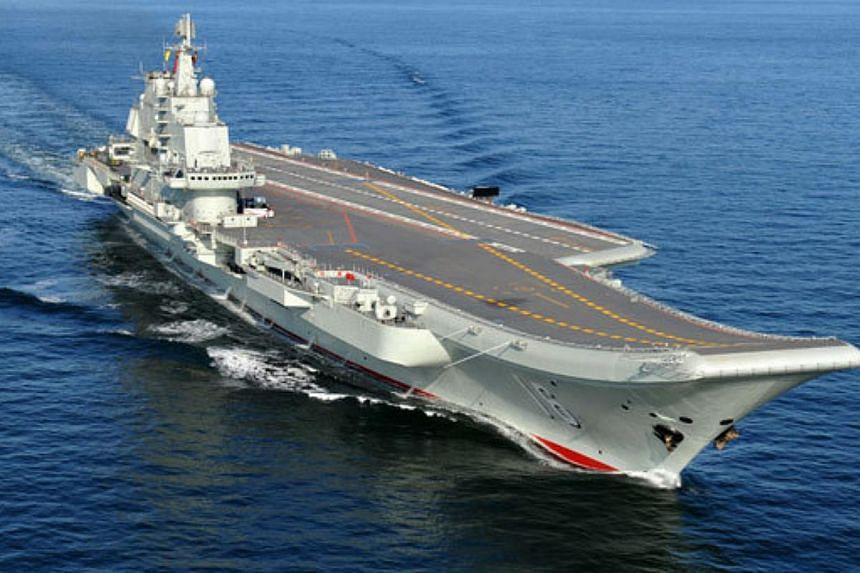 Chinese aircraft carrier Liaoning undergoing sea trials. A Chinese man has been arrestedfor taking photos of an aircraft carrier base in Qingdao and selling them to a foreigner, state broadcaster CCTV said on Saturday.-- PHOTO:CHINA