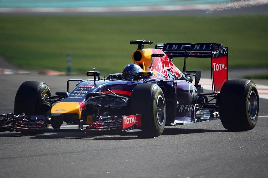 Red Bull Racing's German driver Sebastian Vettel drives during the third practice session at the Yas Marina circuit in Abu Dhabi on Nov 22, 2014 ahead of the Abu Dhabi Formula One Grand Prix. -- PHOTO: AFP