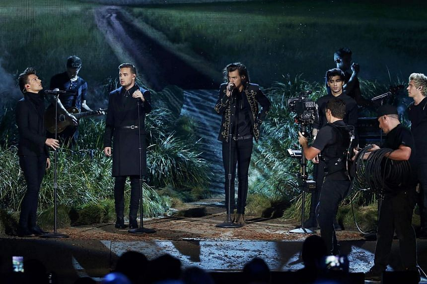 One Direction performs Night Changes on stage during the 42nd American Music Awards in Los Angeles, California on Nov 23, 2014. -- PHOTO: REUTERS