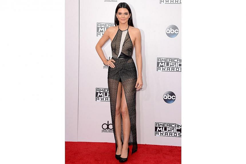 Kendall Jenner, reality star and aspiring supermodel, is wearing a high-fashion shower curtain over her thighs. -- PHOTO: AFP