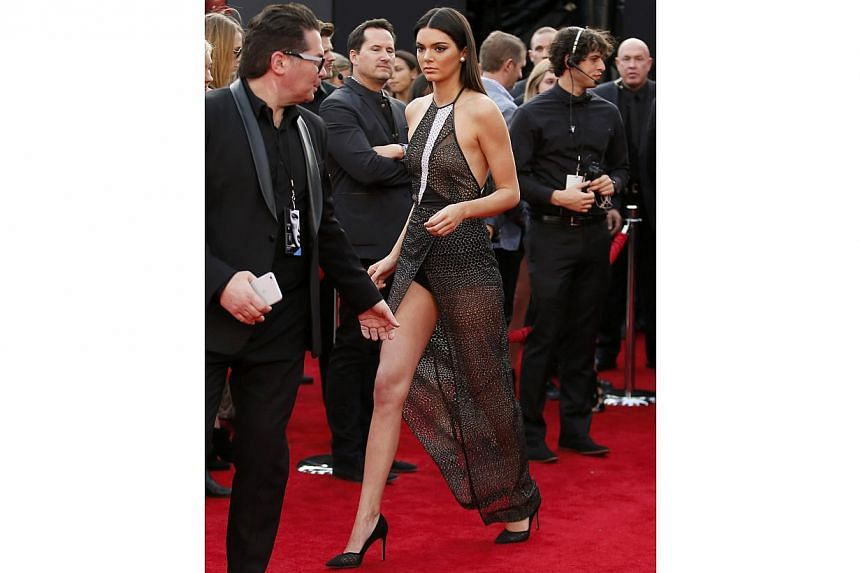 Kendall Jenner, reality star and aspiring supermodel, is wearing a high-fashion shower curtain over her thighs. -- PHOTO: REUTERS