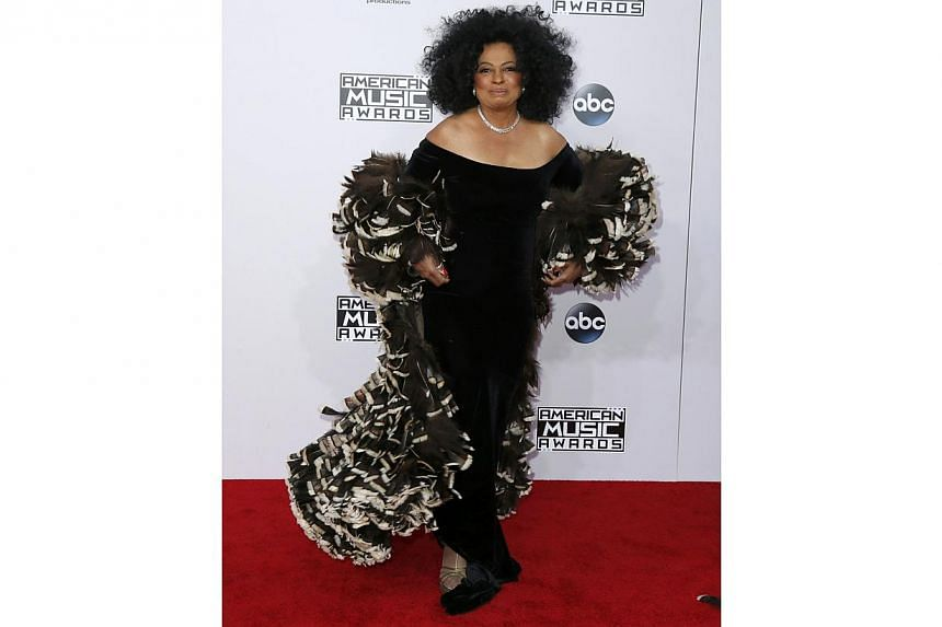 Diana Ross, wrapped in a fabulous shawl, shows the rest how real pop divas hit the red carpet. -- PHOTO: REUTERS