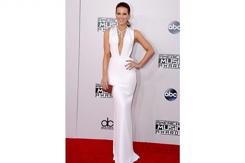 Actress Kate Beckinsale brings Hollywood glamour - and boobs - to the party. -- PHOTO: AFP
