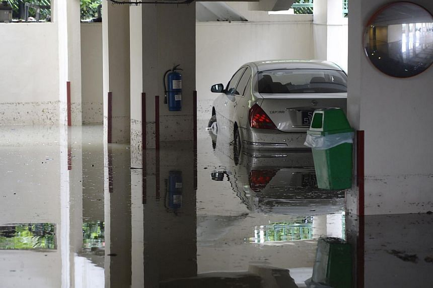 A partially submerged car in the basement carpark of the Fortune Park condomunium along Tampines Road, near Kovan.Singapore is looking far ahead to identify the risks of coastal and inland flooding here due to climate change. ST PHOTO:DES
