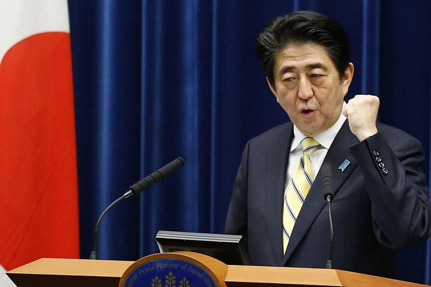 Japanese voters, puzzled as to why Prime Minister Shinzo Abe is calling an election now and unimpressed by opposition alternatives, may shun a Dec 14 election in record numbers. -- PHOTO: REUTERS