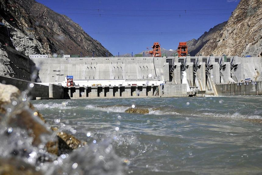 This picture taken on Nov 23, 2014 shows the Zangmu Hydropower Station in Gyaca county in Lhoka, or Shannan prefecture, southwest China's Tibet region. -- PHOTO: AFP