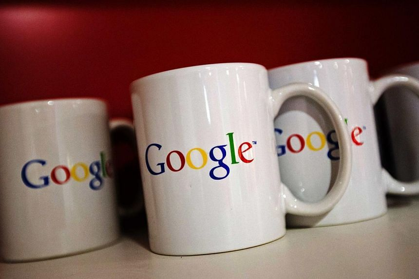 Coffee cups with Google logos are seen at the new Google office in Toronto, in this file photo taken Nov 13, 2012. -- PHOTO: REUTERS