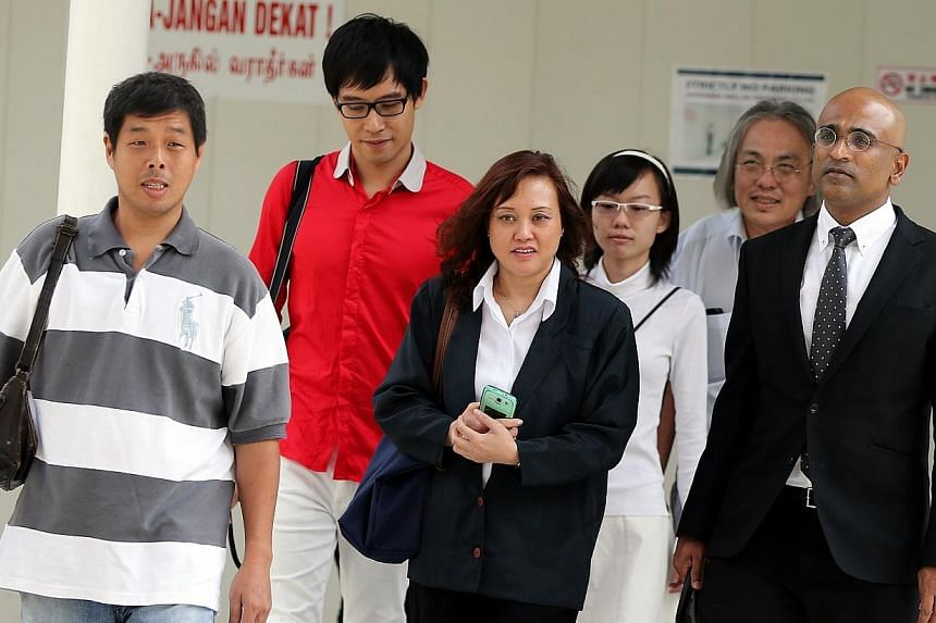 (From left) MrGoh Aik Huat, Mr Roy Ngerng, Ms Low Wai Choo, Ms Han Hui Hui, Mr Koh Yew Beng and their lawyer Mr Ravi, arriving at the State Courts on Monday, Nov 24, 2014. The pre-trial conference for the case involving six people charged with