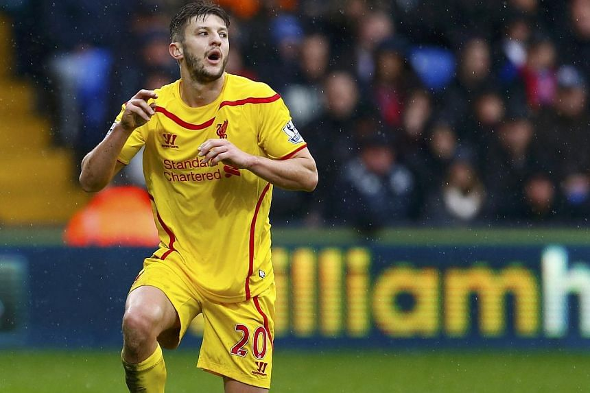 Liverpool's Adam Lallana reacts to a missed opportunity during their English Premier League football match against Crystal Palace at Selhurst Park in London on Nov 23, 2014. -- PHOTO: REUTERS