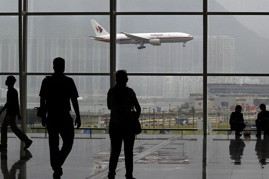 A Malaysia Airlines Boeing 777 plane is seen from the departure hall at the Hong Kong International Airport, in this June 2, 2011 file photo.Malaysian flights currently fly through Iranian and Turkish airspace to reach destinations in Europe to