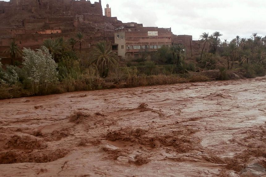 Swollen flood waters coarse through the southern region of Ouarzazate in Morocco on Nov 23, 2014. -- PHOTO: AFP