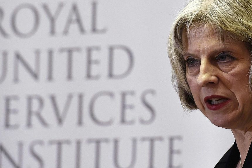 Britain's Home Secretary Theresa May delivers a speech at RUSI (Royal United Services Institute) in central London, on Nov 24, 2014. -- PHOTO: REUTERS
